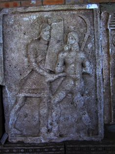 Adamclisi Metope. Legionary stabbing Dacian warrior in the torso.