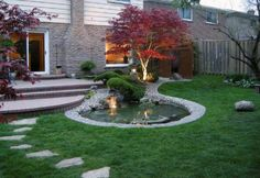 Q Le designed a beautiful asian garden in toronto with nice transition of gravel border pond to the green lawn features red emperor 1 japanese maple to draw attention