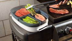 Porter - Grab and Grill    This summer helper is smokin' hot! Porter is a multi-purpose BBQ tray that eliminates extra trips between your kitchen and grill. Containers with lids keep raw food safely separated, while a serving platter and condiment caddy hold everything a grill chef needs at hand. This is sure to make your next cookout a blast.