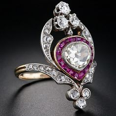 Edwardian Diamond Calibre Ruby Ring in Platinum over 18 Karat Yellow Gold Circa 1900.