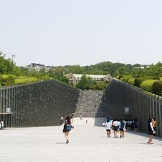 """Ewha Womans University: Architects: Dominique Perrault Architecture Location: Seoul, South Korea Area: 70000.0 sqm Project Year: 2008 The giant underground atrium mitigates the complexity of the site. """"Campus Valley"""" became the new topography of the site bringing interactive activities among students and neighbors."""