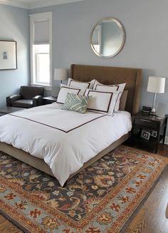 Crisp, clean lines ~ beautiful rug over great wood floor