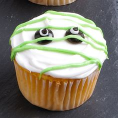 Mummy Cupcakes  Decorate this super-easy Halloween cupcake by starting with two candy-coated chocolate pieces for eyes. Add frosting and mini chocolate chips to eyes, then crisscross the cupcake with green icing. You're done!