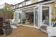 Bi-folding UPVC Here we have six doors - parting in the centre allowing the two central doors to be opened in a similar way to patio doors and also the whole rear of the extension to open up when both sets of doors are folded to the sides