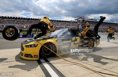 Brad Keselowski, driver of the Alliance Truck Parts Ford, crashes into his crew on pit road during the NASCAR Sprint Cup Series Windows 10 400 at Pocono Raceway on August 2015 in Long Pond,. Get premium, high resolution news photos at Getty Images Nascar Costume, Brad Keselowski, Nascar Sprint Cup, Sport Photography, Sports Photos, Fast Cars, Celebrity Photos, Truck Parts, Trucks
