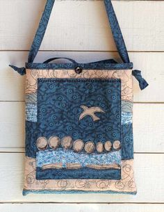 DJ Pettitt's purses and totes are useable pieces of art.