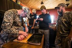 Hank Shaw, left, demonstrates how to dress a goose with Dennis McNamara, of Kerrville, Andy Spencer of Bay City, and Robert Mrray, Sr., of Wadsworth, at the Coastal Wings hunting lodge on Tuesday, Nov. 18, 2014, in Bay City. Shaw, who describes himself as a cook who hunts, leads groups on water fowl hunts and then teaches them to prepare their take. ( Brett Coomer / Houston Chronicle )