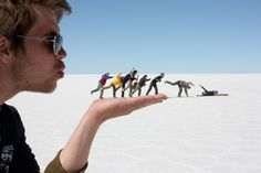26 perfect examples of forced perspective photography: 06. Blowing in the Wind by Jeppe Olsen image