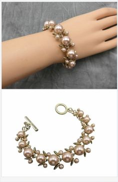 """Champagne colored pearls might be the perfect accent when bright white pearls just won't work.  Medium and small champagne pearls paired with golden """"leaves"""" create a preppy toggle bracelet great for a professional day to day style or special occasion."""