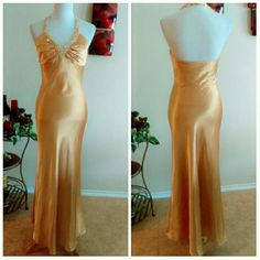 Sleek Gold Satin Gown This lovely golden gown is made from a soft satin that draps and flows over curves. I recently sold a vintage one..same color and style..funny how styles come right back around:) This one has lovely ruching around the bust flattering that area.  Crystal beading adorns a halter neck giving it just a tiny bit of sparkle without the glitter:) Dress seems to fit a 6-7 best. Tag reads 7-8. 57 inchs hollow to hem. 34,30, 39 True Gold Color Make Offers Morgan & Co. Dresses…