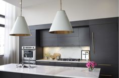 Adding decorative hardware is a simple and inexpensive way to transform your kitchen and make it swoon-worthy! I also love the brass in the oversized Aero light fixtures that hang above the honed Calacatta marble island. Kitchen Interior, New Kitchen, Kitchen Dining, Kitchen Modern, Minimalist Kitchen, Kitchen Ideas, Dining Room, Hub Home, Brooklyn Apartment