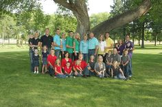 awesome idea to color scheme individual families for a large family photo shoot!