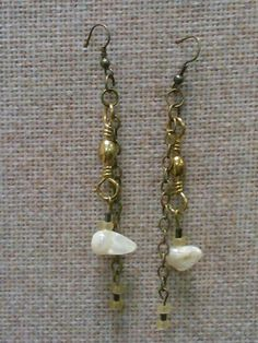 """my latest earrings. made from reclaimed jewelry and a hint of """"tackle"""""""