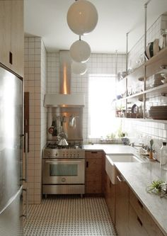 In this article about how to best live large in a small space, I feature the following: kitchen storage; mosaic tile; open shelving | Architect: Lauren Wegel