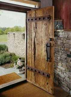 Rustic reclaimed barn wood door. Wood has so much character and gets more beautiful with age.