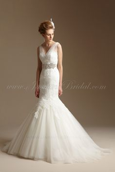 Beautiful lace and tulle wedding gown.  Available at Elena Bridal, NY