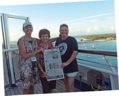 Marian Jackson, Virginia Ortiz, and Karen Fournier cruise through The Taos News on the Carnival Conquest while in port in Grand Turk.