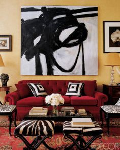 Elle Decor ~ ACCEPT THE UNEXPECTED...A large, graphic painting inspired by Franz Kline takes center stage in this living room designed by Miles Redd, on New York's Upper East Side. The furniture and accessories complement the painting's dramatic black and white lines—custom embroidered upholstery by Penn & Fletcher on the chairs, zebra ottomans, and black and white accent pillows on the sofa.