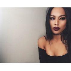 stunning purple lipstick on brown skin