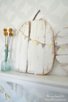 This light and airy pumpkin made of pallet s the detail you never knew your mantel needed. Click through for more ways to be creative with pallet this fall.