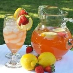 Freshly Squeezed Lemon Juice And Orange Slices Are Combined With A Sweetened Strawberry Mixture To Create A Long, Cool Drink For Summer.
