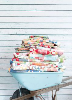 Now I know what to do with my vintage aqua wheelbarrow. it would be great for quilt storage! Antique Quilts, Vintage Quilts, Vintage Fabrics, Quilt Ladder, Quilt Display, Quilt Storage, Fat Quarter Shop, Quilt Kits, Tutorials