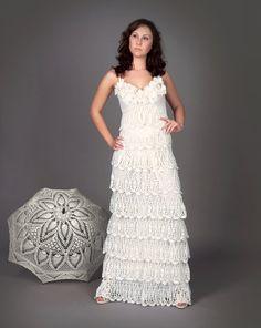 Exclusive long crochet wedding dress with crochet umbrella via Etsy.