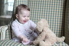 Princess Charlotte is too cute, as she plays with her stuffed animal in this photo taken by mom, Kate Middleton.
