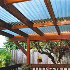 cedar deck w/ polycarbonate patio cover and recycled gates | deck ... - Patio Roof Ideas