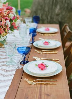 a flower on each place setting, photo by Lauren Fair Photography…