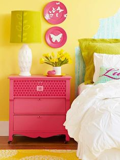 Love this pink night table and colorful room.