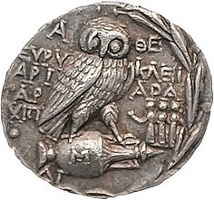 old Greek coin - the owl of the Goddess Athena, a coin of ancient Athens