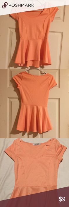 Peplum styled top Orange peplum styled top. Good condition, gently used. Runs true to size. Feature faux pearl detailing on the shoulder area. Wear with a pair of jeans or a skirt! Tops