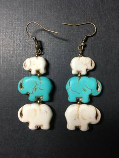 Elephant family earring single or pair Wildlife fundraiser Kwanzaa lucky charm Gift mother sister father partner daughter friend man woman Elephant Jewelry, Elephant Earrings, Elephant Colour, Symbols Of Strength, Nickel Free Earrings, Elephant Family, Kwanzaa, Lucky Charm