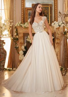 Crystallized Embroidery on Soft Tulle Ball Gown Wedding Dress Designed by Madeline Gardner. Removable Beaded Satin Belt included.