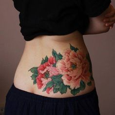 Chronic Ink Tattoo - Toronto Tattoo Peony tattoo on the lower back side done by Master Ma.