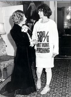 "Margaret Thatcher meets Katharine Hamnett, 1984 Whilst meeting Thatcher, Hamnett wears one of her iconic t-shirts which said ""58% don't want pershing"", in reference to polls showing opposition to base Pershing missiles in this country."