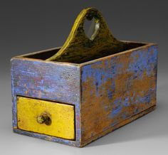 Paint-Decorated Pine Candle Box - Lot 696 from July 2012 Auction    Probably American, second half 19th century, pine throughout with cut nail construction, single dovetailed drawer and heart-pierced handle, traces of original paint, 10-1/2 x 4 x 7 in.    Estimate $200 to $300