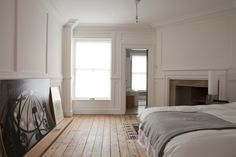 William Smalley flat in Bloomsbury, wood floors, white paneled walls