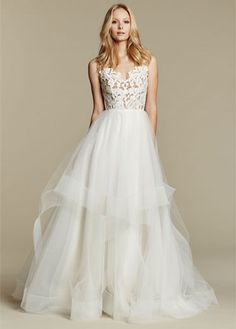 """""""Halo"""" gown. Ivory lace and tulle bridal ball gown, scalloped V-neck bodice with low open back and strap detail, tiered tulle skirt with horsehair trim."""