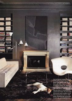 "scandinaviancollectors: ""Tom Ford and Richard Buckley´s Paris apartment, House & Garden Charles & Ray Eames La Chaise lounge chair, Photo by Todd Eberle. / The Art of The Room "" Tom Ford Interior, Charles Ray Eames, Smooth Fox Terriers, Industrial Living, Dark Walls, Dark Interiors, Gothic House, Paris Apartments, Monochrom"