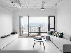 White living room. Features with Normann Copenhagen Tablo Table Large and HAY DLM side table. Tai Tsai Residence by Tai & Architectural Design. Photo by Kyle Yu.