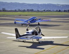 2014 Cirrus SR22GTS N511MC and Lockheed 12A N18906 on the ramp at Livermore Airport in California. 2016.