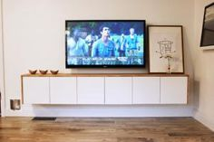 The following five DIY TV stands conceal cable boxes, game consoles, and cord clutter.: How to Make a Modern TV Console