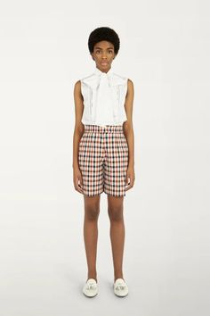 Tailored from a panama check fabric, these shorts offer a colourful take on tomboy dressing. Pair them with the matching tailored jacket for a mode... Tailored Shorts, Tailored Jacket, Ruffle Shirt, Sleeveless Shirt, Modern Suits, Check Fabric, Striped Fabrics, How To Make Bows, Tomboy