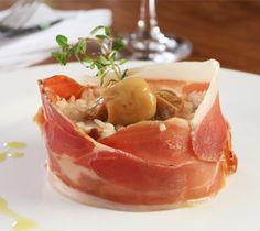 Ristto di funghi porcini con prosciutto di Parma aromatizzato all olio di tartufo bianco