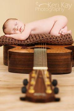newborn guitar photography pose