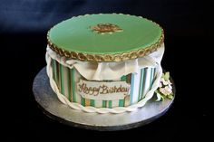 Gorgeous green, gold, and white-striped birthday cake: simple, elegant, and classical. @PartyFlavors #PartyFlavors