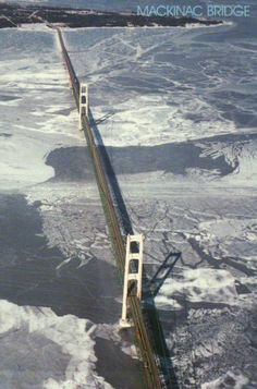 Aerial View of The Mackinac Bridge, Michigan, Winter, Ice + Snow, on Lake Michigan where it meets Lake Huron Michigan Travel, State Of Michigan, Detroit Michigan, Northern Michigan, Lake Michigan, Michigan Facts, Michigan Tourism, Mackinac Bridge, Upper Peninsula