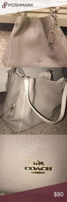 Light grey / toupee coach purse Great condition on the outside ! The inside has a few marks and sports so will discount that in price ! LOVED this bag Coach Bags Shoulder Bags